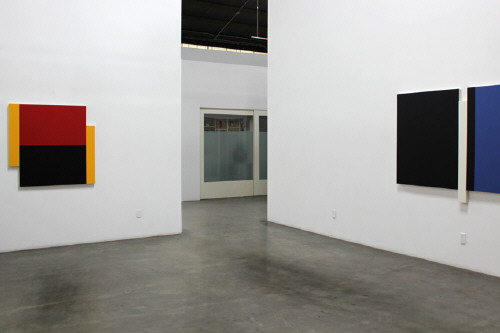 Artist: Scot Heywood, Title: Installation View left to right: Poles Yellow, Red, Blue, 2012; Sunyata Black, Blue, White, 2012 - click for larger image