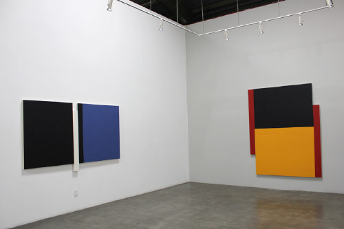 Artist: Scot Heywood, Title: Installation View left to right: Sunyata Black, Blue, White, 2012; Two Poles Red, Yellow, Blue, 2011 - click for larger image
